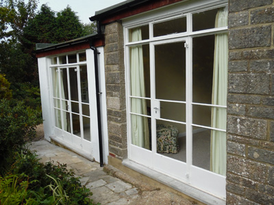 Metal Crittall windows in white gloss