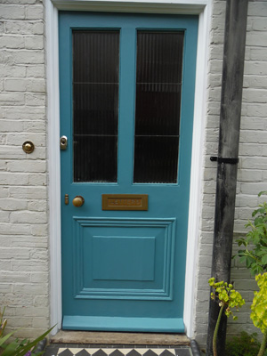 After, front door in a water-based teal